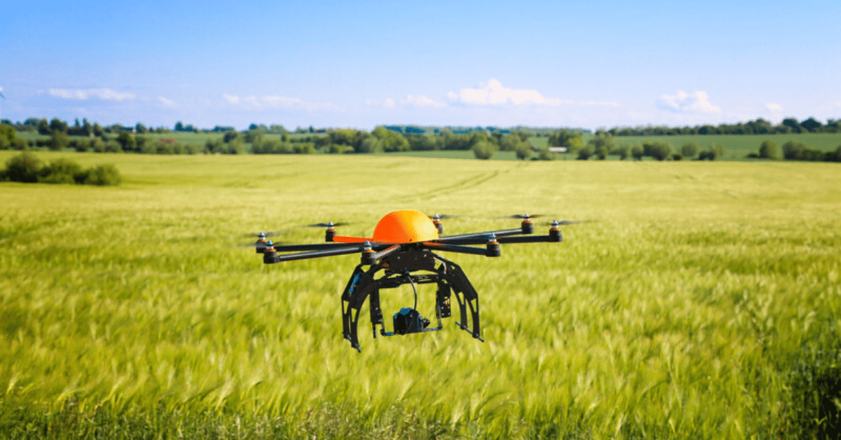 Metal Detecting Drone flying in field of tall green grass.