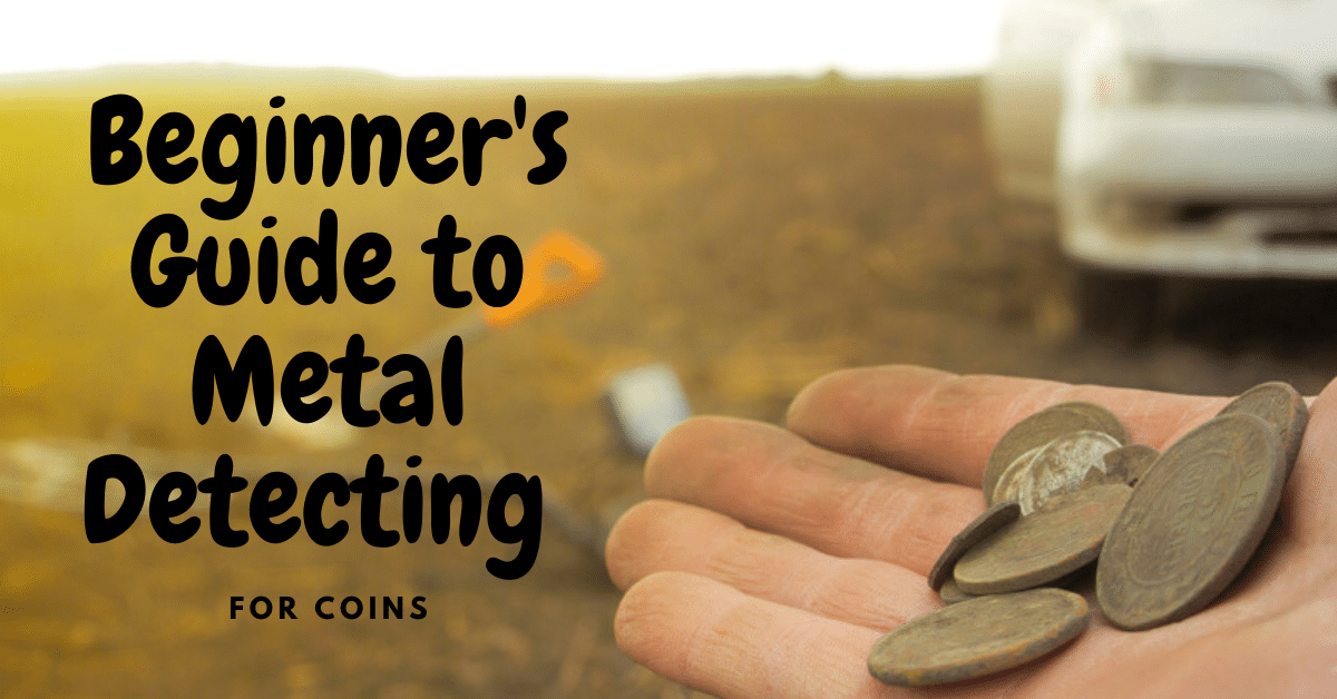 Man holding coins while metal detecting. Beginner's guide to metal detecting for coins.
