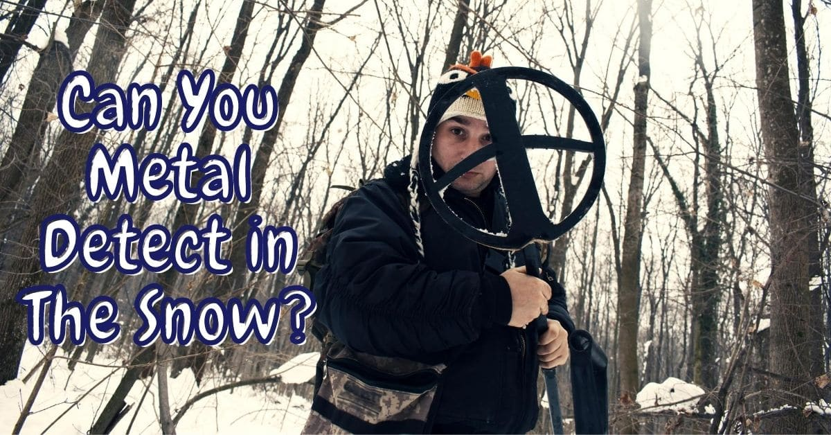Person holding a metal detector and the words can you metal detect in the snow
