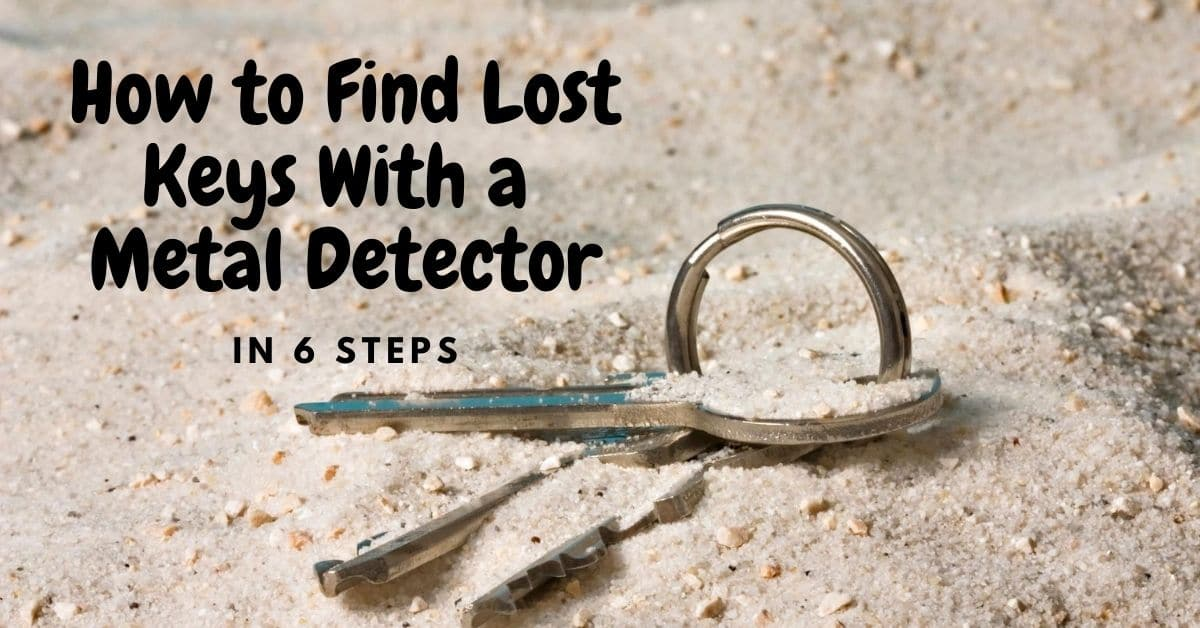 Keys in sand and the words how to find lost keys with a metal detector in 6 steps.