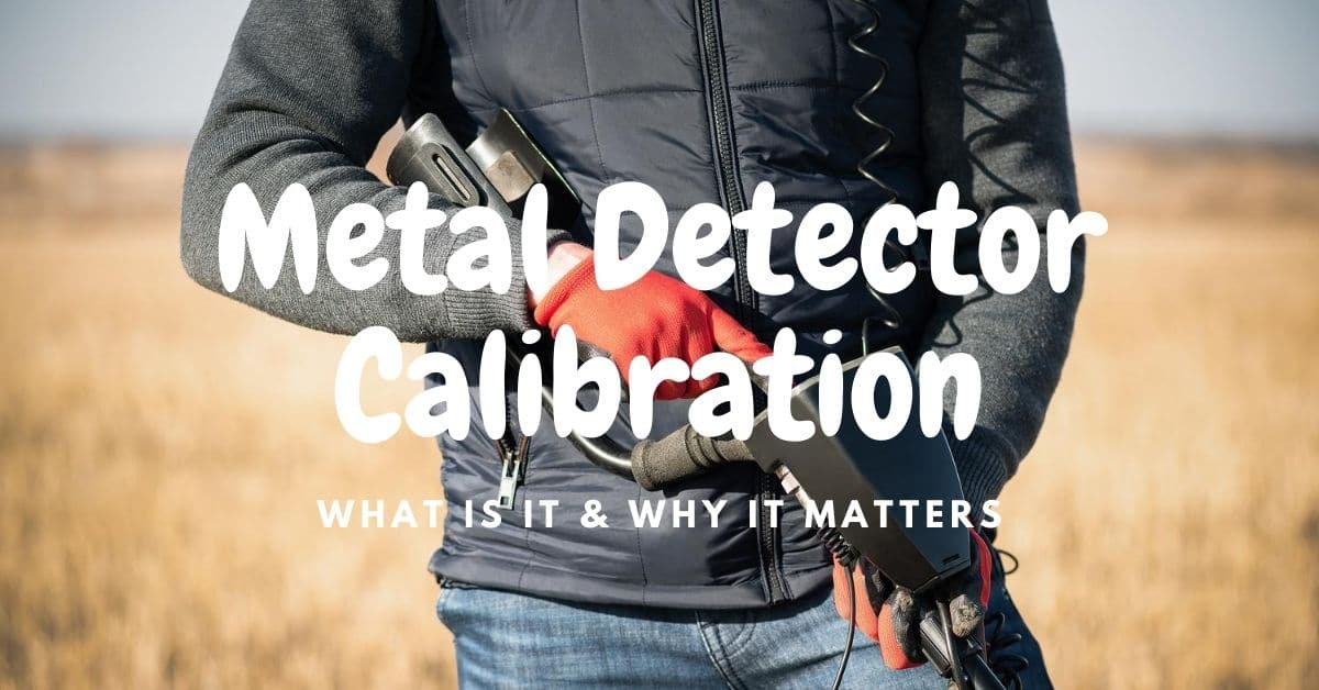 Man holding a metal detector and the words metal detector calibration.