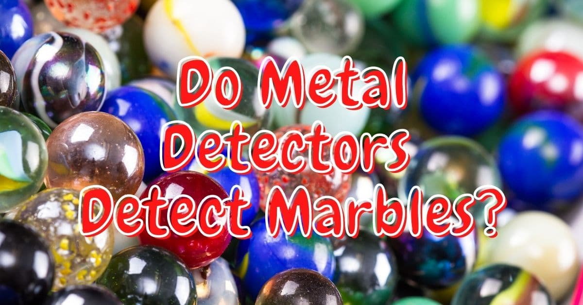 A bunch of marbles and the words do metal detectors detect marbles.