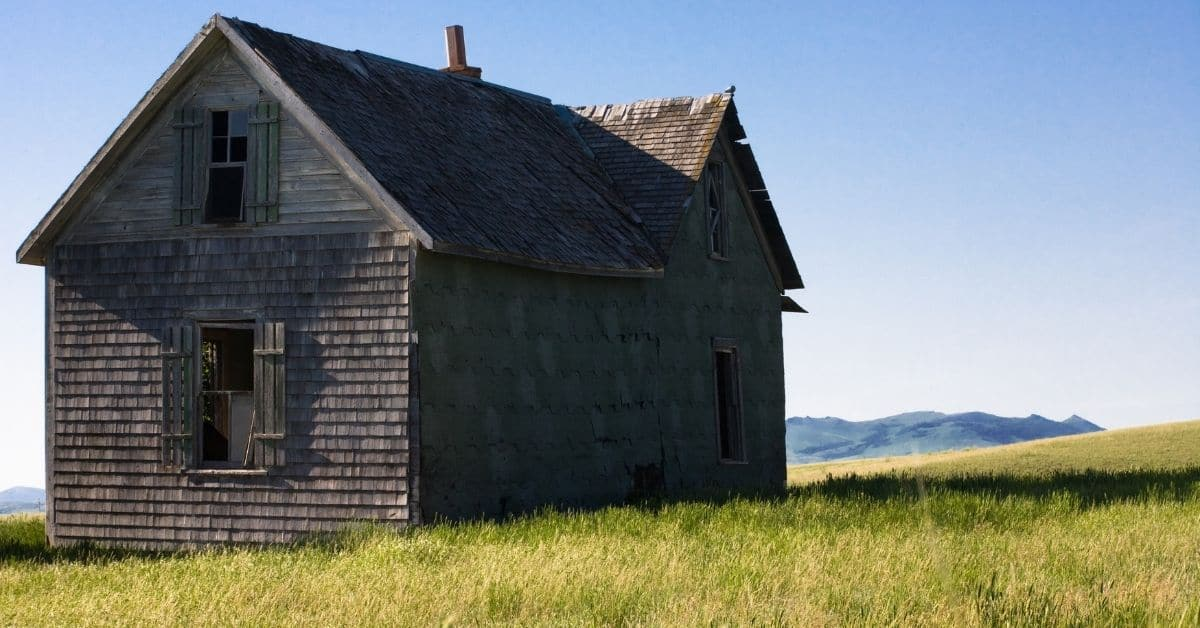 Old homestead in middle of a field.