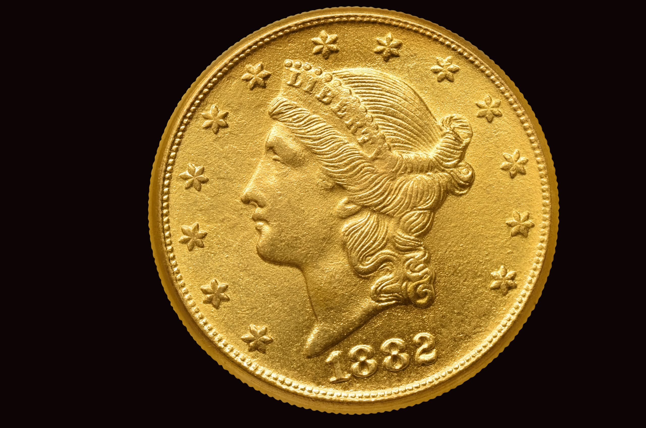 20 Liberty golden dollar coin. Isolated with path on black background