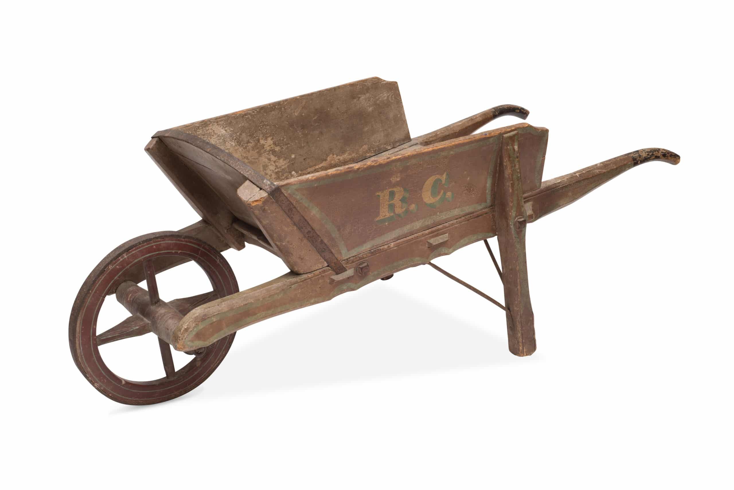 Cut-out of an antique wooden wheelbarrow.