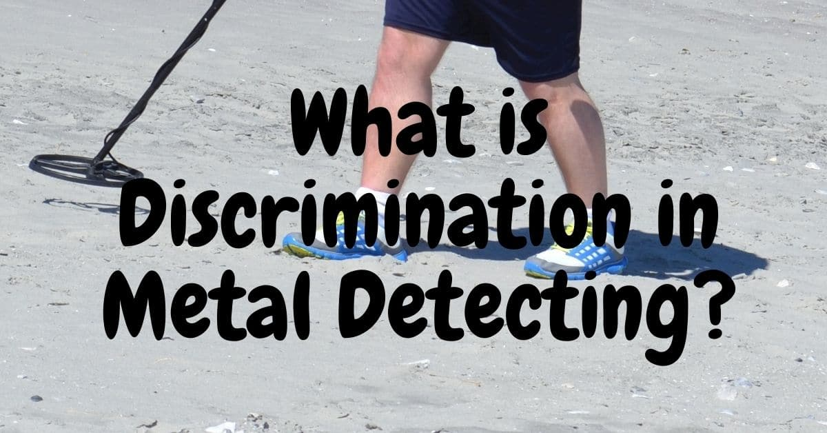 Man walking with a metal detector on the beach and the words what is discrimination in metal detecting.