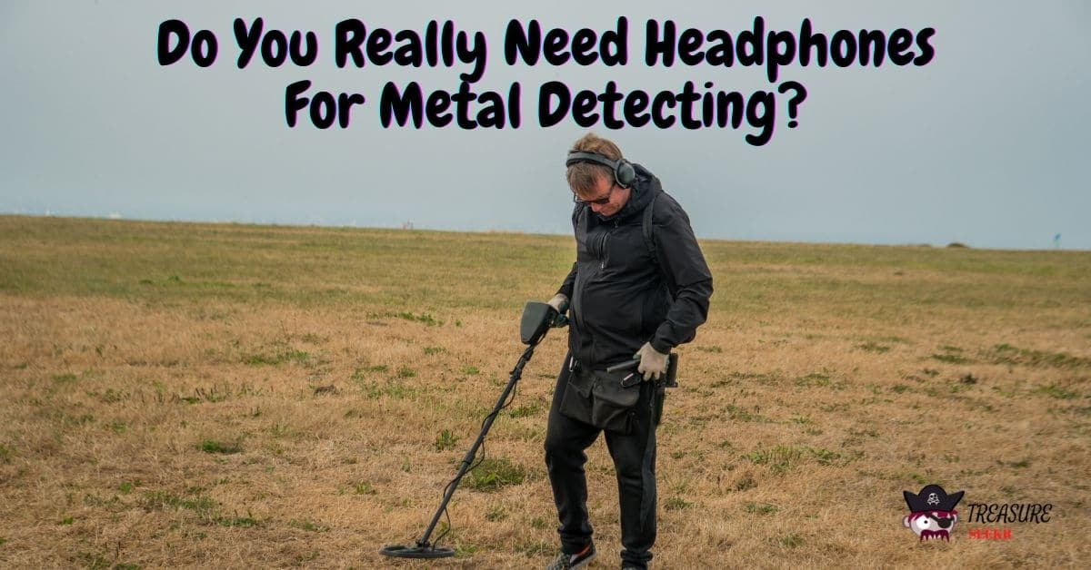 Picture of a man metal detecting in a field wearing headphones - Do You Really Need Headphones For Metal Detecting