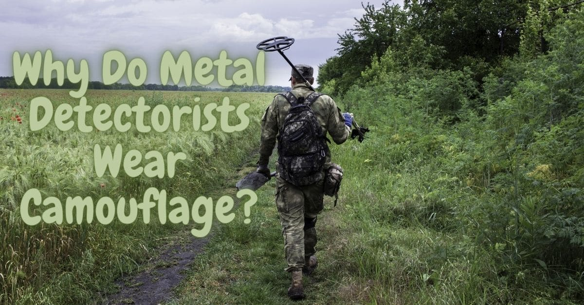 Man walking in a field with a metal detector wearing camouflage